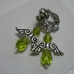 Angel earrings, green with silver clip on.