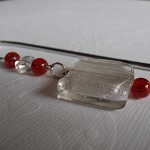 Silver bookmark with white/silver, red beads. B11.