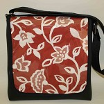 Black vinyl shoulder bag with red floral feature flap
