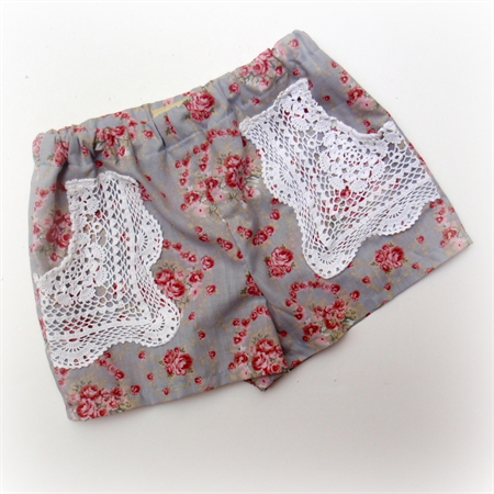 Pretty floral vintage girls shorts with upcycled lace pockets. Sizes 2 ~ 8