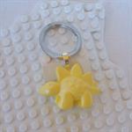 DINO-TASTIC! - Stegosaurus dinosaur shaped bag tag hand cast in yellow resin.