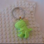 DINO-TASTIC! - Tyrannosaurus dinosaur shaped bag tag handcast in green resin.