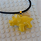 DINO-TASTIC - Triceratops dinosaur shaped hand cast resin pendant in yellow