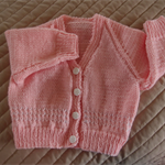 SIZE  6-12 mths  knitted cardigan in peachy pink & white by CuddleCorner