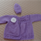 Size 0-6 months hand knitted baby jacket/cardigan & beanie in purple & rosette