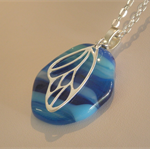 Silver Angel Wing Blue Skies Artisan Glass Pendant by Curly Jo
