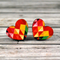 Geometric wooden heart disc earrings.