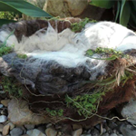 Deluxe Nest photography prop for newborn baby. Made from natural fibres
