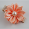 Beautiful Apricot Satin Flower Clip with flower detail.