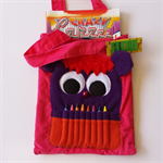 Hot pink corduroy monster colouring in bag with crayon teeth