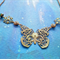 Vintage old-gold and patina butterfly necklace