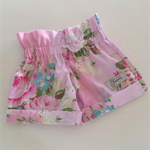 Girls gorgeous cuff shorts made with stunning pink floral fabric