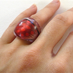 Red Ring with feathers in resin