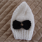 Size 0-6months hand knitted beanie in white with detachable bow: Unisex