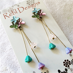 Hand Coloured Flower Studs in pastel blue green and pink