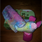 """Miss Nellie rattle with  matching burp cloth"""