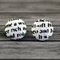 Buy 2 pairs and get a third set free (Fabric button studs only). Tabloid