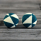 Buy 2 sets, get 3rd free (Fabric button studs only). Triangles, teal