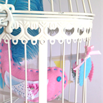 Whimsy bird in vintage cage felt bird with real feather tail & diamonte eye's!