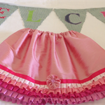 Girls pink frills party skirt.