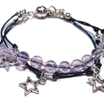 Silver stars and violet leather charm bracelet
