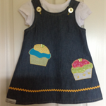 2 in 1 reversible denim dress size 3 with appliqued cup cakes.