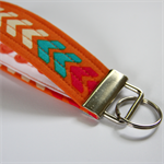 Wrist Key Fob - Bright arrows on orange with bikes