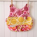 SOLD  Reversible Bib - Tula Pink fabric, pink and chartruese