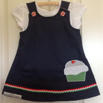 2 in 1 reversible navy dress with appliquéd cupcake. Size 2