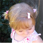 Sweet pink 3pk toddler pigtail hair set.