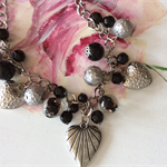 Gorgeous black and Tibet silver bracelet charms and beads adjustable one only