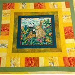 Animals in the zoo cot quilt / floor play rug.