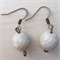 White faceted ceramic bead earrings.