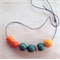 Felt ball and bead necklace.