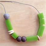 Felt ball and recycled bead necklace.