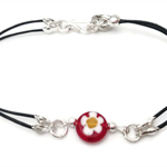 Leather bracelet with vibrant red glass flower