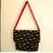 Womens black and red large messenger bag with inside pocket
