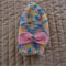 Size 2-4 yrs hand knitted beanie in multi colour with bow; washable, OOAK