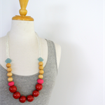 Red Wood Necklace with Hot Pink, Turquoise and Natural Wood on Clear Glass
