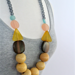 Light Wood Necklace with Yellow, Peach and Turquoise on Frosted Grey Glass