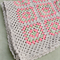 beige crochet blanket with coral and green, wool, bedding