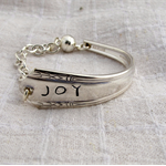 Hand stamped bracelet made from vintage silver plated cutlery.