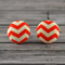 Buy 2 pairs and get third set free (Fabric button studs only). Orange Chevron