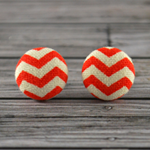 Buy 3 pairs and get 4th set free (Fabric button studs only). Orange Chevron