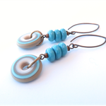 Circuitous blue glass and brass hook earrings