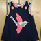 Denim bird pinafore size 2.