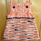 Orange and navy print pinafore size 2.