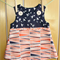 Orange and navy print pinafore size 0.