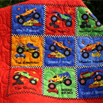 Monster Trucks in bright colors - this quilt that could  double as a play mat