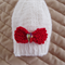 Size 0-6 mths hand knitted white beanie and red bow by CuddleCorner: Prop